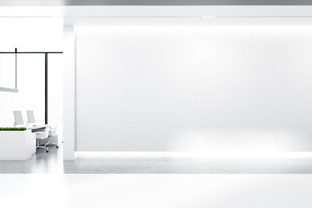 Minimalistic office interior with white walls, concrete floor with rows of massive white tables with black computer screens and panoramic windows. Mock up wall. 3d rendering
