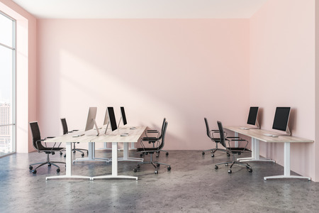 Interior of open plan office with pink walls, a concrete floor, rows of wooden computer desks and panoramic windows. 3d rendering copy space