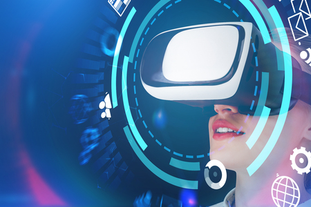 Young caucasian woman in shirt and vr glasses standing over abstract futuristic background with hud and internet icons on it. Hi tech and fintech concept. Toned image double exposure mock up 写真素材