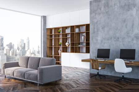 Corner of cozy home office with gray walls, dark wooden floor, dark wooden table with computers on it and bookcase. Gray sofa 3d rendering copy space 版權商用圖片