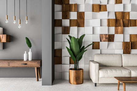 Close up of white and wooden tiled wall living room interior with concrete floor, white sofa, and coffee table. Wooden cabinet on the left. 3d rendering