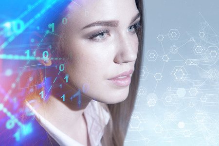 Portrait of beautiful blonde businesswoman with binary numbers and graphs interface and network hologram on gray wall. Toned image double exposure Imagens