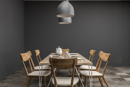 Dining room interior with gray walls and long wooden table with chairs and two ceiling lamps hanging above it. Front view. 3d rendering