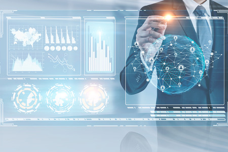 Unrecognizable businessman working with global business network hologram and infographics in his office. Toned image double exposure Elements of this image furnished by NASA Stock fotó