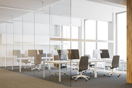 Side view of office workplace interior white white and glass walls, loft windows, carpet on the floor and rows of white computer tables with desktops and gray chairs. Wooden column 3d rendering