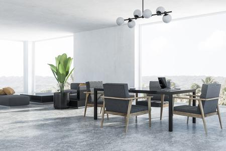 Coin de la salle à manger et du salon modernes aux murs blancs, sol en béton, table noire avec fauteuils gris et canapé gris près de la table basse noire. rendu 3D