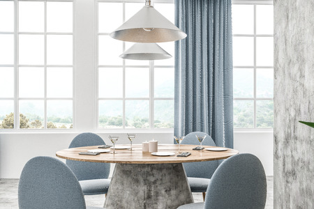 Modern cafe interior with white and concrete walls, concrete floor and round wooden table with blue chairs. Blue curtains on the windows. 3d rendering