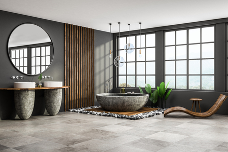 Corner of modern bathroom with gray and wooden walls, tiled floor, round gray bathtub, two white sinks with big round mirror and wooden armchair. 3d rendering