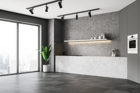 Corner of modern kitchen with concrete walls, tiled floor, gray cupboard with built in oven and concrete countertops. 3d rendering Reklamní fotografie