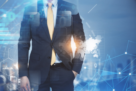 Businessman standing with his hand in pocket over night cityscape background with business infographics interface. 写真素材