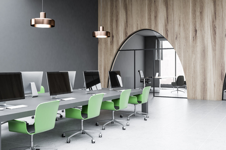 Corner of modern office with gray and wooden walls, tied floor and long gray computer table with green chairs. Ceo office seen through arched door. 3d rendering Banco de Imagens