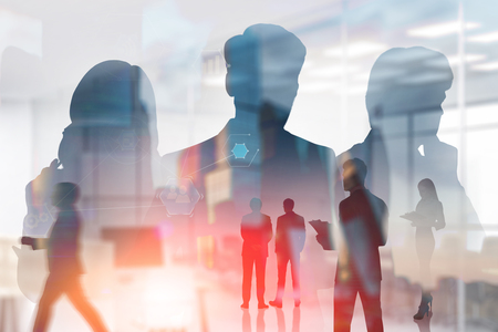 Silhouettes of managers with double exposure of business people working in office over cityscape background with business interface. Toned image 写真素材
