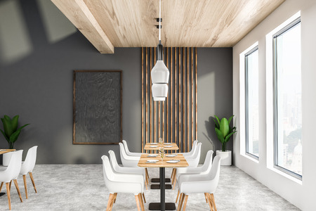 Interior of modern cafe with gray and white walls, concrete floor, loft windows, wooden tables with white chairs and blackboard on the wall. 3d rendering Stock Photo