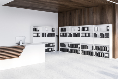 White and wooden reception desk standing on office lobby with white and wooden walls and bookcases with folders. 3d rendering Banque d'images - 115167450