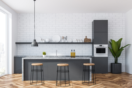 Interior of kitchen with white brick walls, wooden floor, panoramic window, gray and marble countertops and bar with stools. 3d rendering Stock Photo