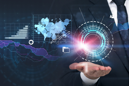 Hand of unrecognizable businessman holding hud and immersive business infographics interface.