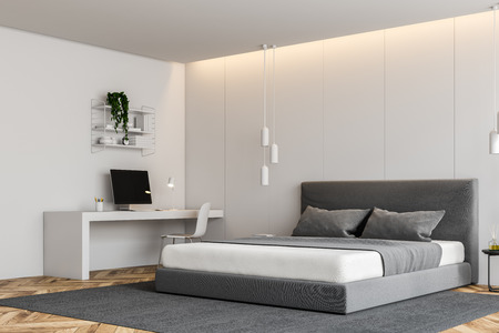 Corner of modern bedroom with white walls, wooden floor, gray master bed on carpet and white computer table. 3d rendering