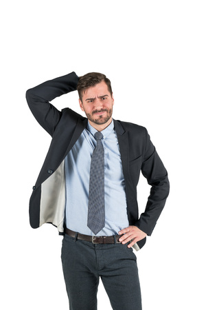 Isolated portrait of confused thinking bearded businessman scratching his head. Concept of decision making