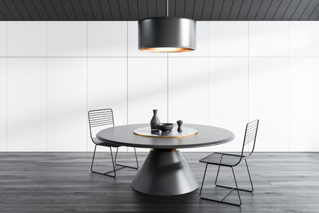 Interior of attic dining room with gray ceiling, white walls, black wooden floor, round table with metal chairs and massive ceiling lamp. 3d rendering