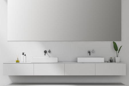 Double bathroom sink standing on white countertop in room with white walls and big horizontal mirror. 3d rendering Stock Photo