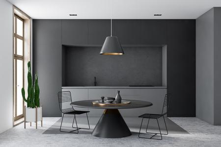 Interieur der modernen Küche mit grauen und weißen Wänden, Wabenmusterboden, grauen Arbeitsplatten und rundem schwarzem Tisch mit Metallstühlen. 3D-Rendering Standard-Bild