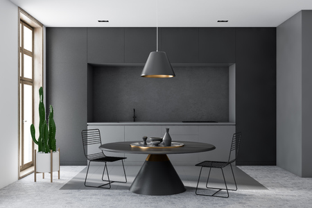 Interior of modern kitchen with gray and white walls, honeycomb pattern floor, gray countertops and round black table with metal chairs. 3d rendering Stockfoto