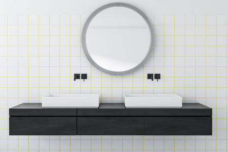 Interior of bathroom with white and white tile walls, double sink standing on black wooden counter and round mirror hanging above it. 3d rendering