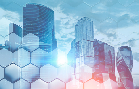 Panorama of Moscow city with cloudy sky and double exposure of hexagonal pattern. Concept of business center. Toned image