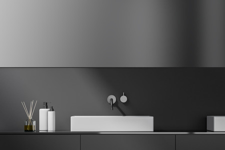 Bathroom sink standing on gray countertop in room with gray walls and big horizontal mirror. 3d rendering