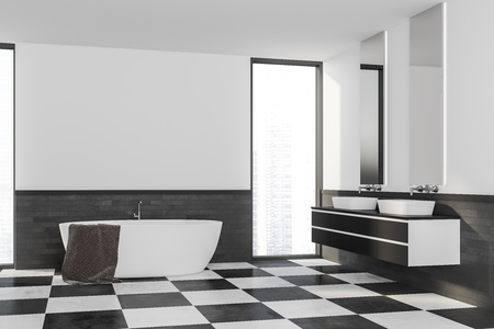 Corner of stylish bathroom with white and gray brick walls, tiled floor, white bathtub and double bathroom sink standing on black and white counter near narrow window. 3d rendering Archivio Fotografico - 117069876
