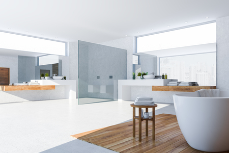 Interior of original bathroom with white walls, concrete floor, white bathtub, two sinks standing on white and wooden countertops and two toilets. 3d rendering Archivio Fotografico - 117070971
