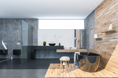 Interior of stylish bathroom with concrete and wooden walls, black bathtub, black sink standing on black countertop and two toilets. 3d rendering Archivio Fotografico - 117071227