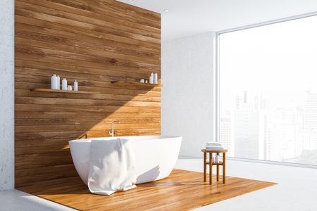 Corner of bathroom with white and wooden walls and floor and white bathtub with towel on it and shelves with shampoo and creams above it. Panoramic window. 3d rendering Archivio Fotografico - 117071235