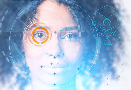 Head of beautiful young African American woman with face recognition technology and HUD around eye. Toned image Stock Photo