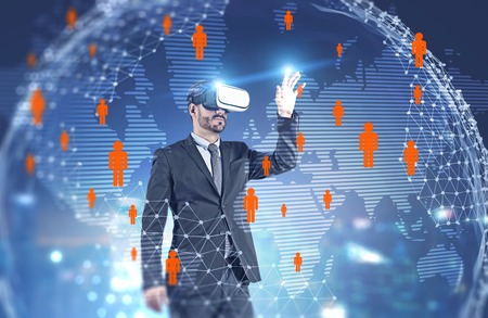 Bearded businessman in vr glasses working with people network hologram over planet background. Toned image double exposure. Elements of this image furnished by NASA Stockfoto