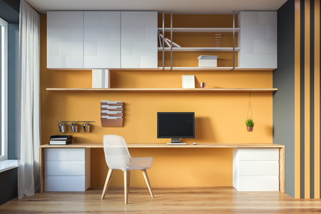 Interior of modern home office with yellow and gray walls, wooden floor and long computer table with bookshelves above it. 3d rendering mock up
