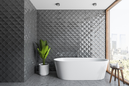 Interior of stylish bathroom with gray tile walls, concrete floor, panoramic window and white bathtub standing near potted plant. 3d rendering Stock fotó