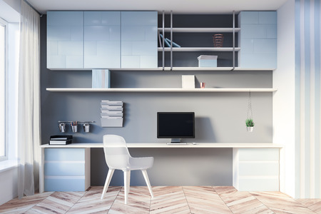 Interior of stylish home office with gray and blue walls, wooden floor, long computer table with desktop and bookshelves above it. Concept of working remotely. 3d rendering