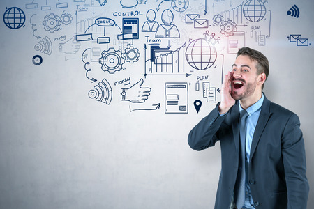 Excited young businessman shouting with his hand near mouth. Concrete wall background with business plan drawing