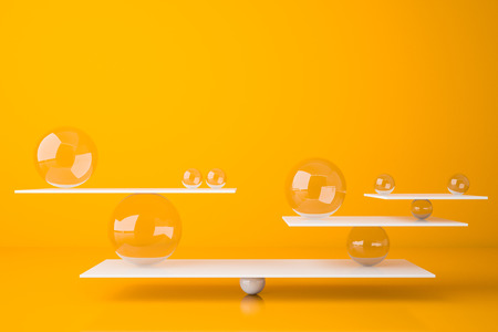 White balanced seesaw with glass balls standing in bright yellow room. Concept of balance and weight. 3d rendering Stock Photo