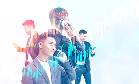Four young diverse businessmen using their smartphones over white background with double exposure of graphs. Concept of trading. Toned image Stockfoto