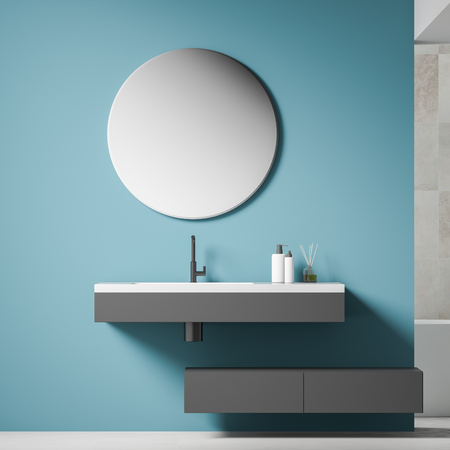 Close up of gray bathroom sink with round mirror above it hanging in modern bathroom with blue walls and white floor. 3d rendering