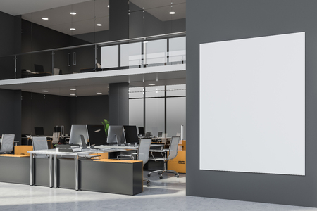 Large vertical mock up banner hanging on business center wall. Two storey office with rows of yellow and gray computer tables. 3d rendering