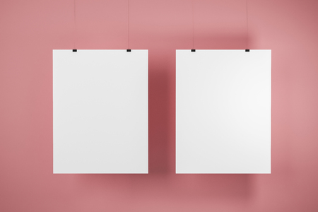 Two vertical mock up pictures hanging on pink wall. Concept of advertising and marketing. 3d rendering Stock Photo