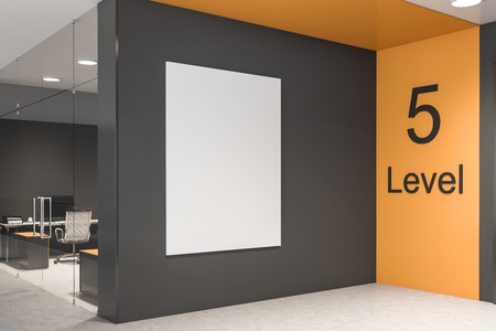 Vertical poster hanging on office wall with gray and yellow walls and computer table behind glass door. Concept of advertising. 3d rendering mock up