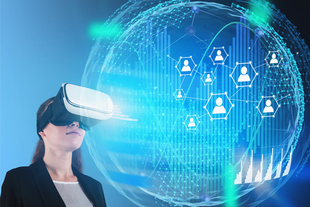 Young businesswoman in VR headset looking at social network and digital technology hologram. Concept of globalization and people network in business. Toned image double exposure