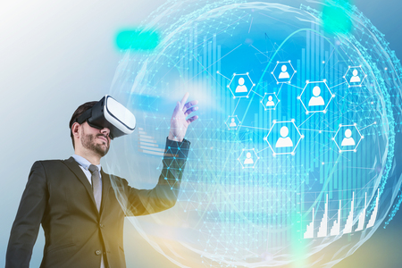 Man in suit and VR headset working with social media and people network hologram in digital world. Concept of hi tech in business. Toned image double exposure
