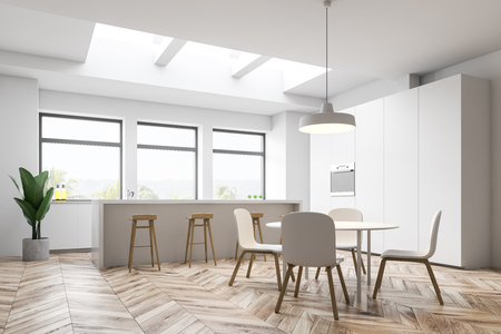 Corner of white kitchen with cupboard with built in stove, white bar with stools, white countertops under large windows and round dining table with chairs. 3d rendering