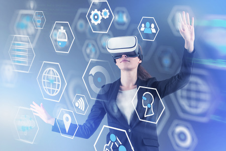 Young woman in virtual reality headset using digital business interface. Concept of automation, big data and futuristic technology. Double exposure