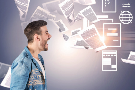 Side view of young man with brown hair wearing casual clothes and screaming. Gray background with papers and electronic documents icons. Concept of paperwork.